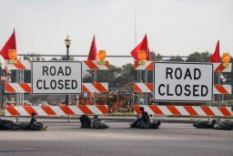 barriers with signage saying road closed